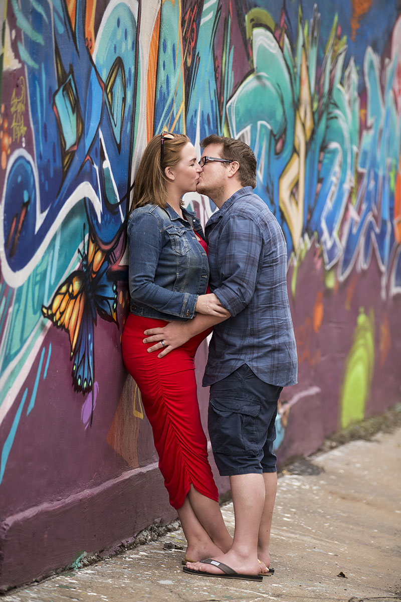 couple-kissing-graffiti-pregnant-henry-summers-photography-best-wedding-photographer-maternity-shoot-durban-gillitts-kwa-zulu-natal