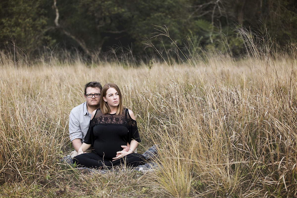 couple-sitting-field-henry-summers-photography-best-wedding-photographer-maternity-shoot-durban-gillitts-kwa-zulu-natal