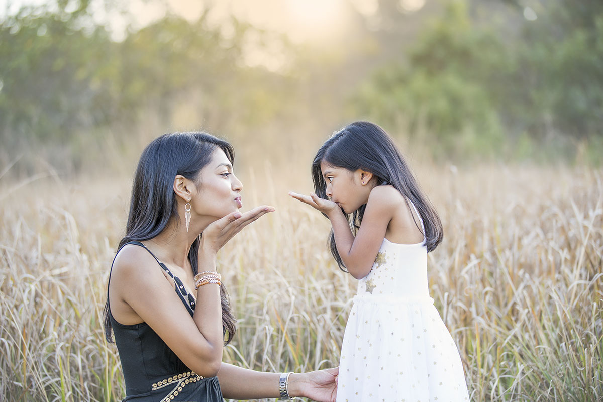 henry-summers-photography-best-wedding-photographer-portfolio-family-mother-daughter-blowing-kisses-durban-gillitts-kwa-zulu-natal
