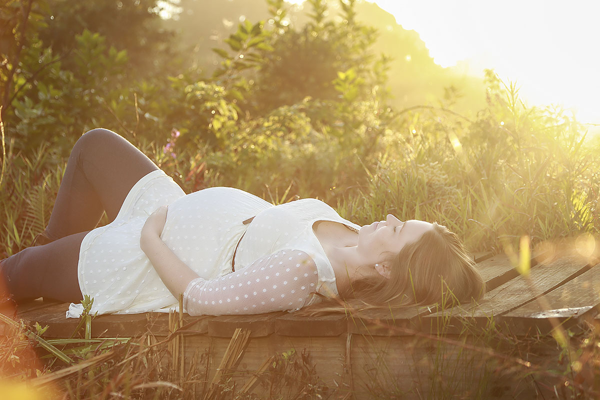 woman-lying-holding-pregnant-belly-sunset-henry-summers-photography-best-wedding-photographer-maternity-shoot-durban-gillitts-kwa-zulu-natal